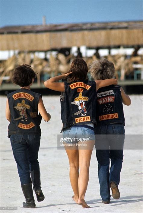 Three girls from the Bandidos gang, shot from behind